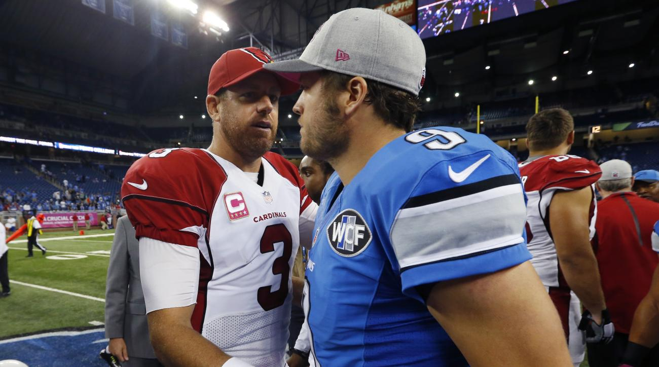 Arizona Cardinals quarterback Carson Palmer (3) meets with Detroit Lions quarterback Matthew Stafford (9) after the Cardinals' 42-17 win in an NFL football game, Sunday, Oct. 11, 2015, in Detroit. (AP Photo/Paul Sancya)