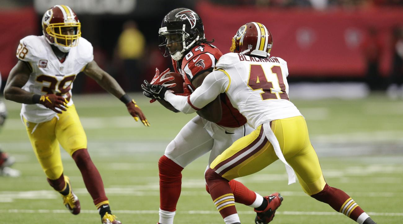 In this Sunday, Oct. 11, 2015 photo, Atlanta Falcons wide receiver Roddy White (84) makes a catch against Washington Redskins defensive back Will Blackmon (41) as Washington Redskins free safety Dashon Goldson (38) looks on during the second half of an NF