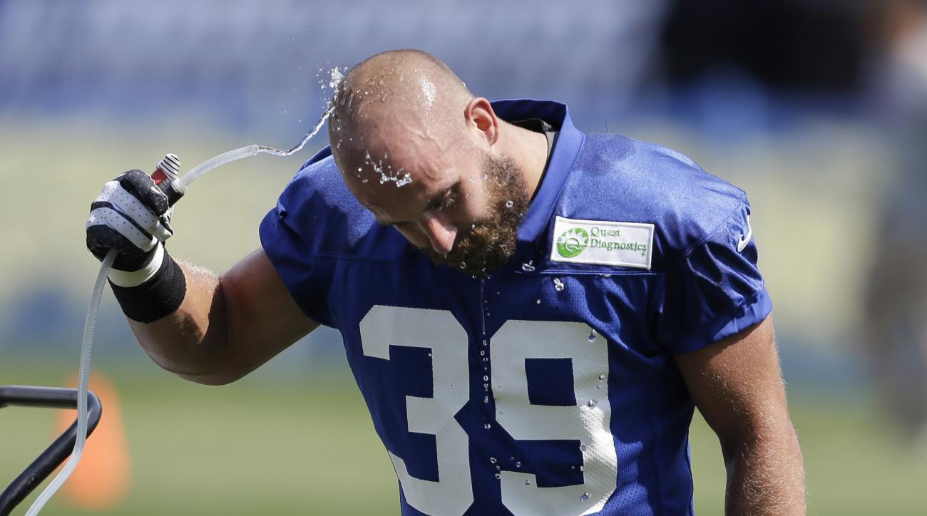 FILE - In this Saturday, July 27, 2013, file photo, New York Giants safety Tyler Sash cools off at a water fountain during NFL football training camp in East Rutherford, N.J. Former NFL and Iowa safety Sash died from an accidental overdose after mixing tw