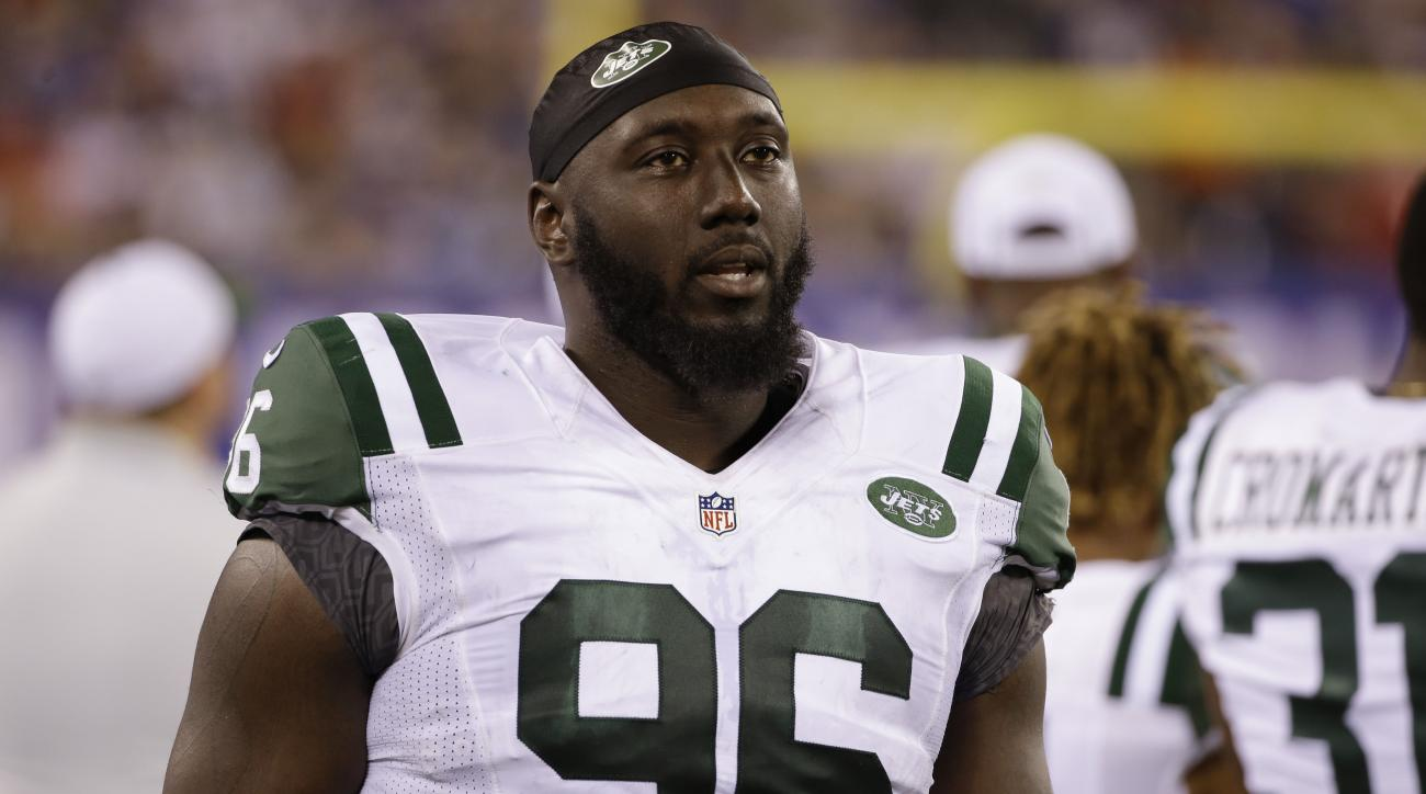 FILE - In this Saturday, Aug. 29, 2015 file photo, New York Jets defensive end Muhammad Wilkerson (96) walks the sidelines during the second half of a preseason NFL football game against the New York Giants in East Rutherford, N.J. Muhammad Wilkerson was
