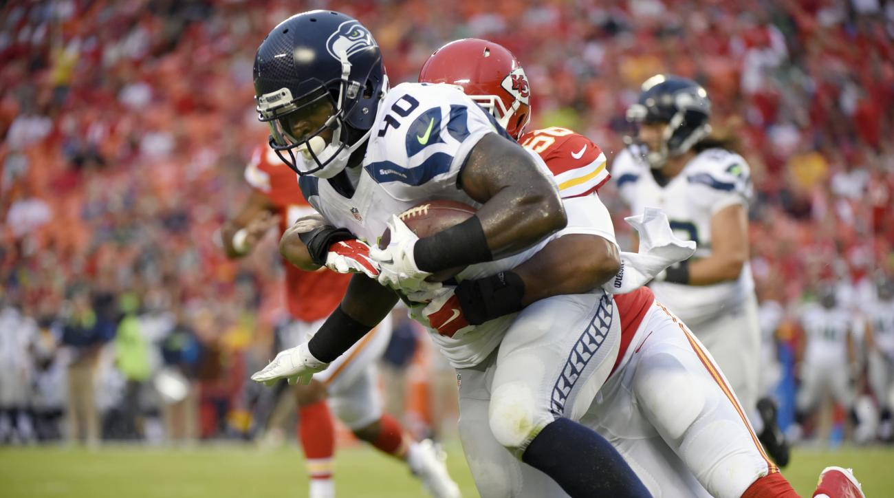Seattle Seahawks fullback Derrick Coleman (40) is tackled by Kansas City Chiefs inside linebacker Derrick Johnson (56) during the first half of an NFL football game at Arrowhead Stadium in Kansas City, Mo., Friday, Aug. 21, 2015. (AP Photo/Ed Zurga)