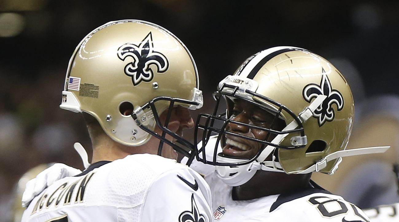 New Orleans Saints tight end Benjamin Watson (82) celebrates his touchdown catch against the Atlanta Falcons with New Orleans Saints quarterback Luke McCown (7) during the second half of an NFL football game, Thursday, Oct. 15, 2015, in New Orleans. (AP P