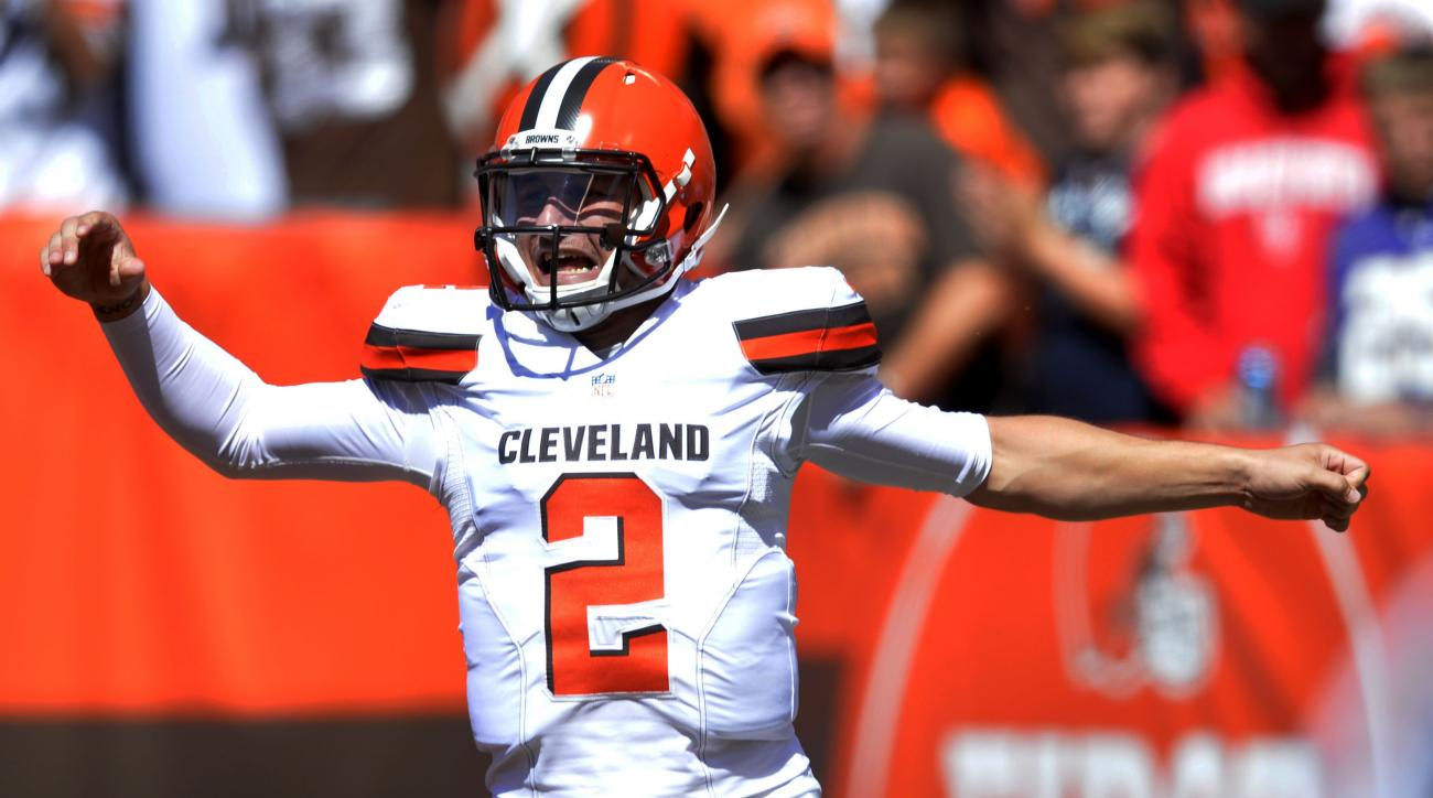 FILE - In this Sunday, Sept. 20, 2015 file photo, Cleveland Browns quarterback Johnny Manziel celebrates after a 60-yard touchdown pass to wide receiver Travis Benjamin in the first half of an NFL football game against the Tennessee Titans in Cleveland. B