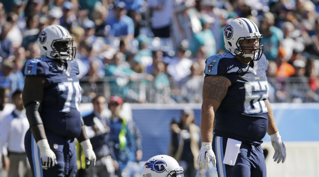 Tennessee Titans quarterback Marcus Mariota (8) stays on the ground after being injured in the first half of an NFL football game against the Miami Dolphins Sunday, Oct. 18, 2015, in Nashville, Tenn. (AP Photo/James Kenney)
