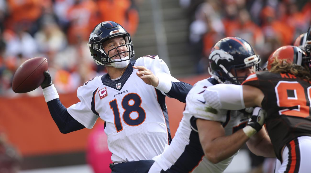 Denver Broncos quarterback Peyton Manning (18) prepare to pass during the first half of an NFL football game against the Cleveland Browns, Sunday, Oct. 18, 2015, in Cleveland. (AP Photo/Aaron Josefczyk)