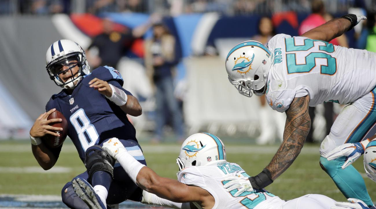 Tennessee Titans quarterback Marcus Mariota (8) is sacked by Miami Dolphins defensive end Olivier Vernon (50) in the first half of an NFL football game Sunday, Oct. 18, 2015, in Nashville, Tenn. (AP Photo/James Kenney)