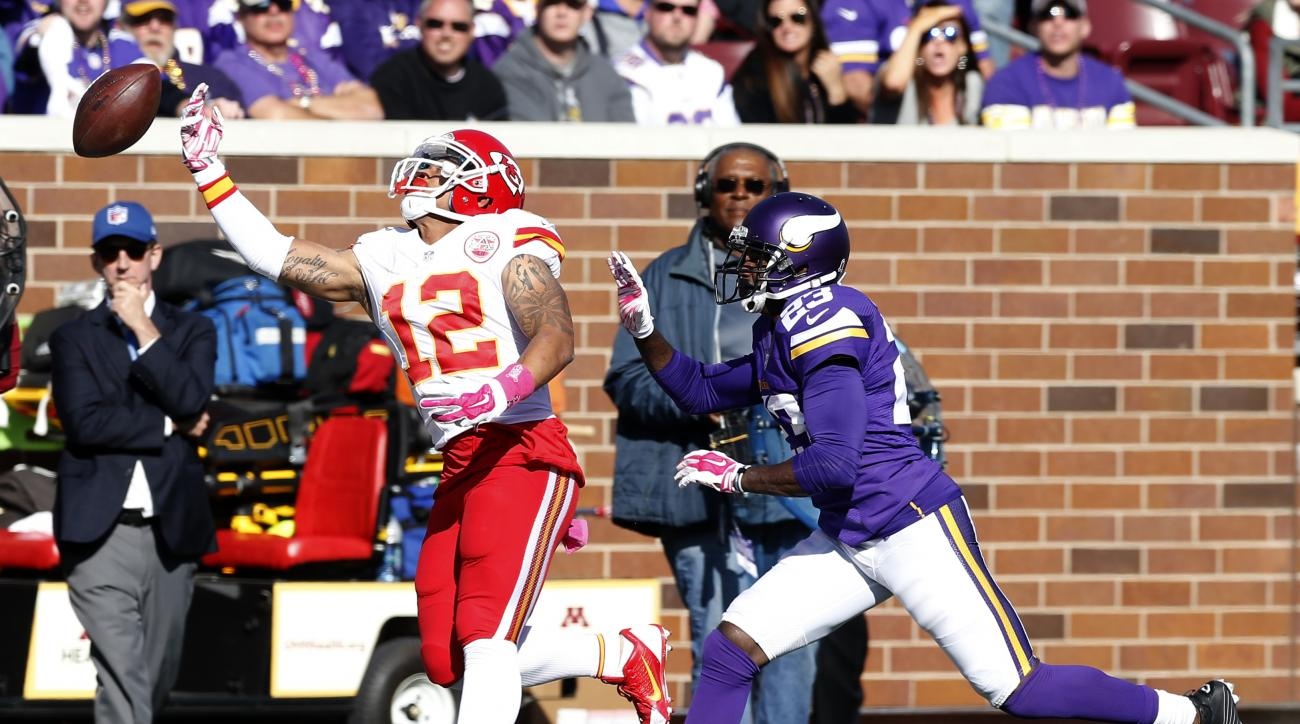 Kansas City Chiefs wide receiver Albert Wilson (12) cannot catch a pass as Minnesota Vikings cornerback Terence Newman (23) defends during the second half of an NFL football game, Sunday, Oct. 18, 2015, in Minneapolis. (AP Photo/Jim Mone)