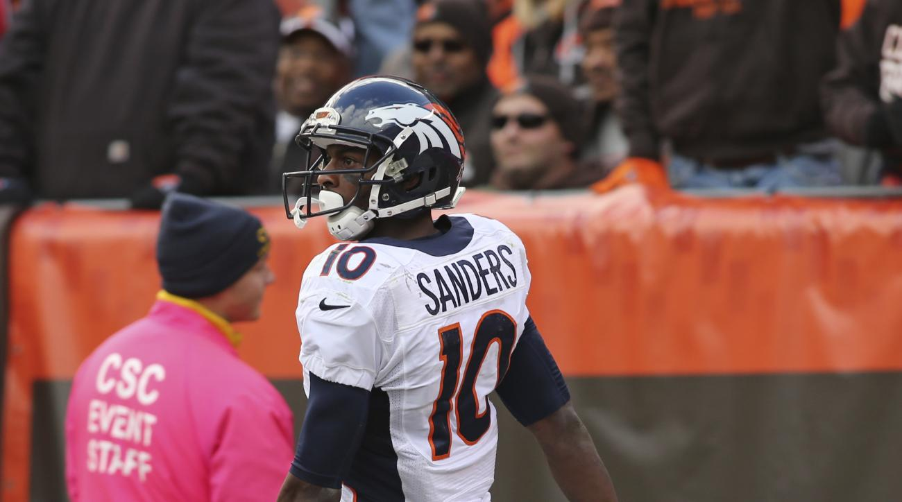 Denver Broncos wide receiver Emmanuel Sanders reacts after a reception during the second half of an NFL football game against the Cleveland Browns, Sunday, Oct. 18, 2015, in Cleveland. (AP Photo/Aaron Josefczyk)