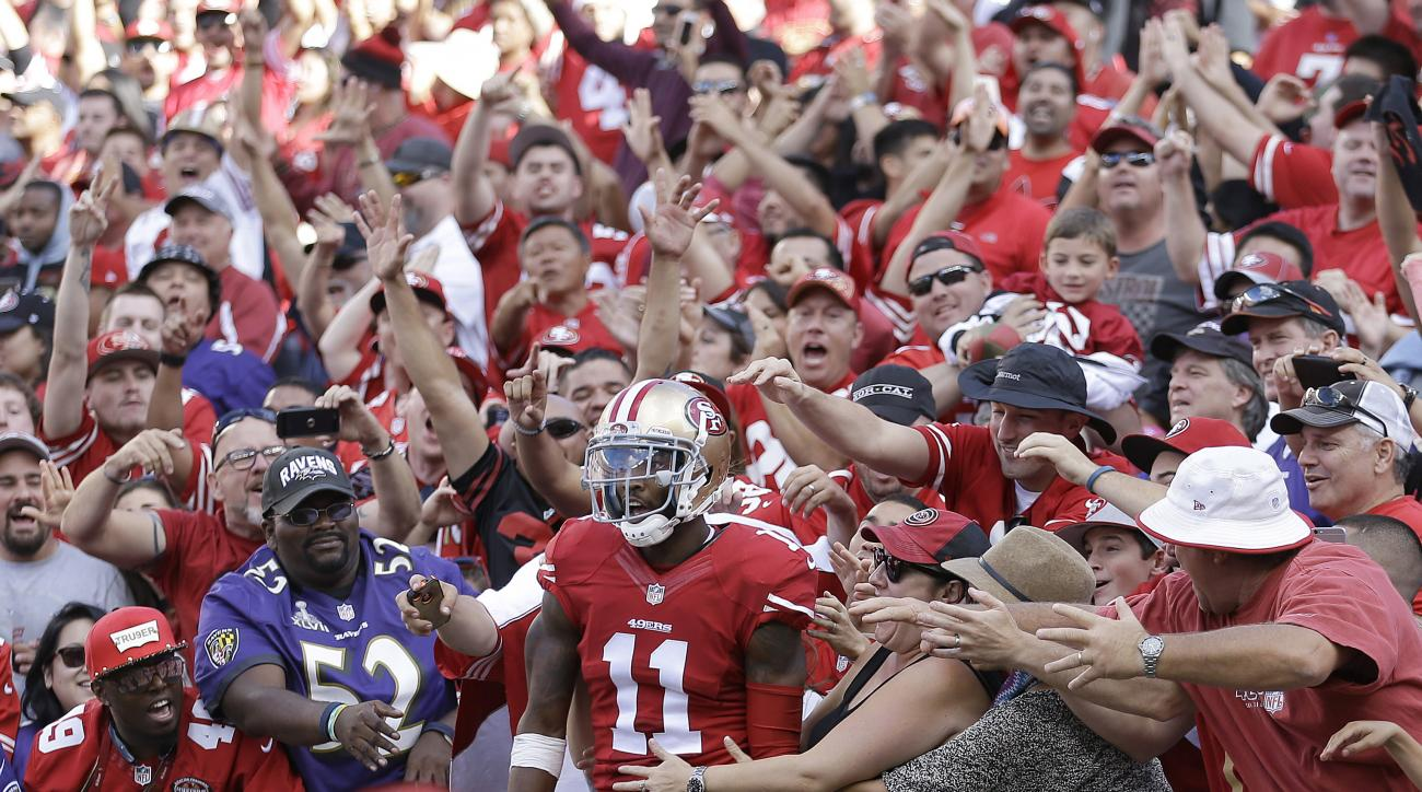 San Francisco 49ers wide receiver Quinton Patton (11) celebrates with fans after scoring on a touchdown reception against the Baltimore Ravens during the second half of an NFL football game in Santa Clara, Calif., Sunday, Oct. 18, 2015. (AP Photo/Ben Marg
