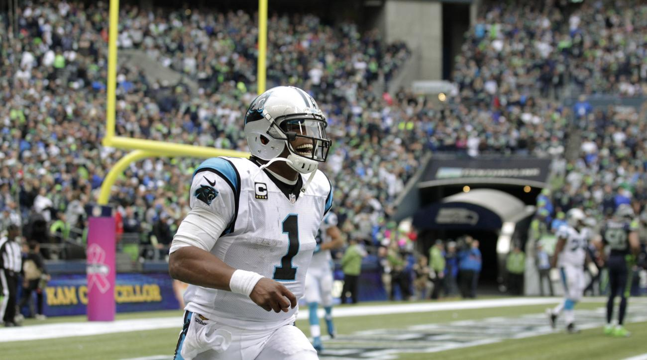 Carolina Panthers quarterback Cam Newton celebrates after he threw a touchdown pass to Greg Olsen in the second half of an NFL football game against the Seattle Seahawks, Sunday, Oct. 18, 2015, in Seattle. The Panthers won 27-23. (AP Photo/Stephen Brashea