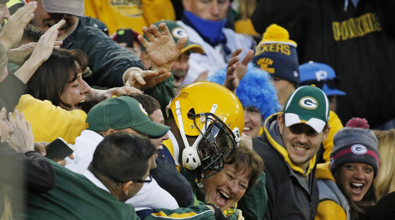 Green Bay Packers' James Jones celebrates with fans after a eight yard touchdown reception during the second half of an NFL football game against the San Diego Chargers, Sunday, Oct. 18, 2015, in Green Bay, Wis. (AP Photo/Mike Roemer)