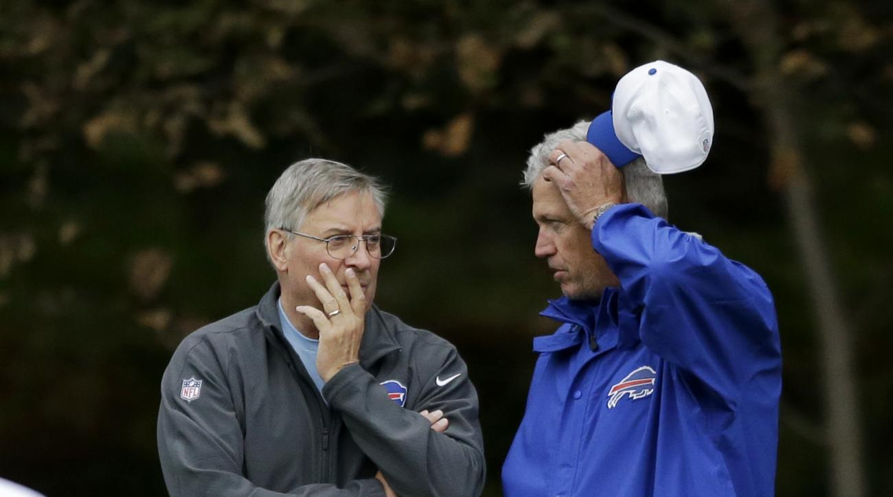 Buffalo Bills head coach Rex Ryan, right, talks with team owner Terry Pegula during an NFL training session at the Grove Hotel in Chandler's Cross, England, Thursday, Oct. 22, 2015. The Buffalo Bills play the Jacksonville Jaguars at Wembley stadium in Lon