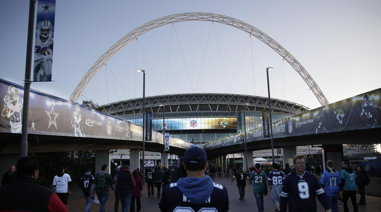 Fans arrive at Wembley Stadium for the NFL football game between the Dallas Cowboys and the Jacksonville Jaguars in London, Sunday, Nov. 9, 2014.  (AP Photo/Matt Dunham)
