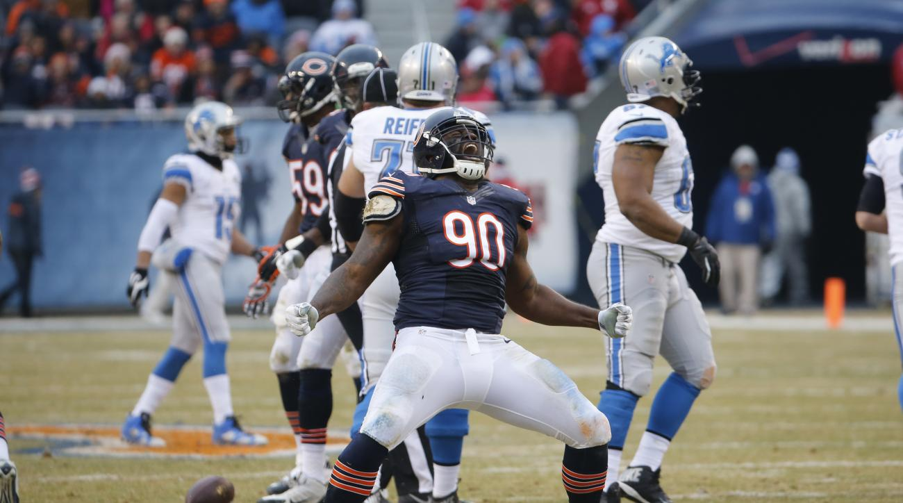 Chicago Bears defensive tackle Jeremiah Ratliff (90) celebrates a sack in the first half of an NFL football game against the Detroit Lions Sunday, Dec. 21, 2014, in Chicago. (AP Photo/Charles Rex Arbogast)