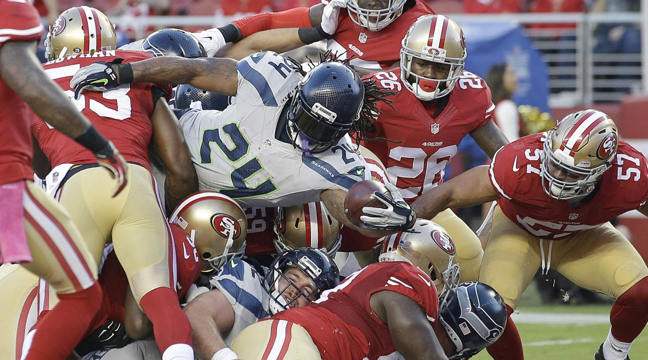 Seattle Seahawks running back Marshawn Lynch (24) runs for a 1-yard touchdown against the San Francisco 49ers during the first half of an NFL football game in Santa Clara, Calif., Thursday, Oct. 22, 2015. (AP Photo/Marcio Jose Sanchez)