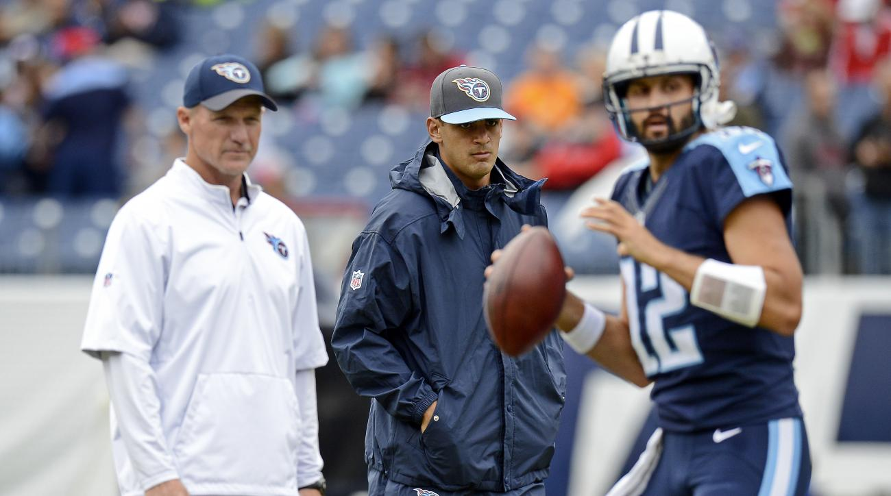 Injured Tennessee Titans quarterback Marcus Mariota, center, watches with head coach Ken Whisenhunt, left, as quarterback Charlie Whitehurst (12) warms up  before an NFL football game between the Titans and the Atlanta Falcons Sunday, Oct. 25, 2015, in Na