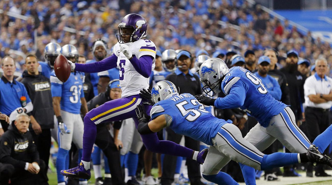 Minnesota Vikings quarterback Teddy Bridgewater (5) is pushed out of bounds by Detroit Lions outside linebacker Kyle Van Noy (53) and defensive end Ezekiel Ansah (94) during the first half of an NFL football game, Sunday, Oct. 25, 2015, in Detroit. (AP Ph
