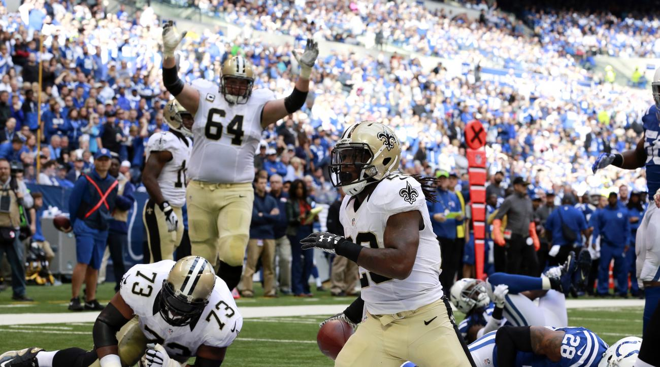 New Orleans Saints tackle Zach Strief (64) celebrates a touchdown by running back Khiry Robinson (29) against the Indianapolis Colts in the first half of an NFL football game in Indianapolis, Sunday, Oct. 25, 2015. (AP Photo/R Brent Smith)