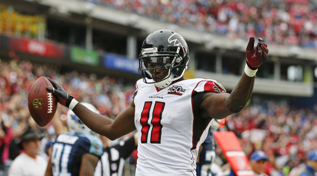 Atlanta Falcons wide receiver Julio Jones celebrates after scoring a touchdown on an 8-yard reception against the Tennessee Titans in the second half of an NFL football game Sunday, Oct. 25, 2015, in Nashville, Tenn. (AP Photo/Weston Kenney)