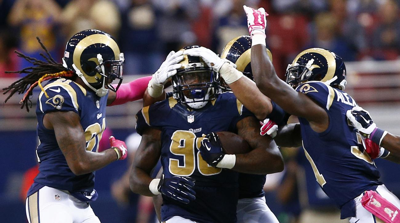 St. Louis Rams defensive tackle Nick Fairley, center, is congratulated by teammates after recovering a fumble during the fourth quarter of an NFL football game against the Cleveland Browns, Sunday, Oct. 25, 2015, in St. Louis. (AP Photo/Billy Hurst)