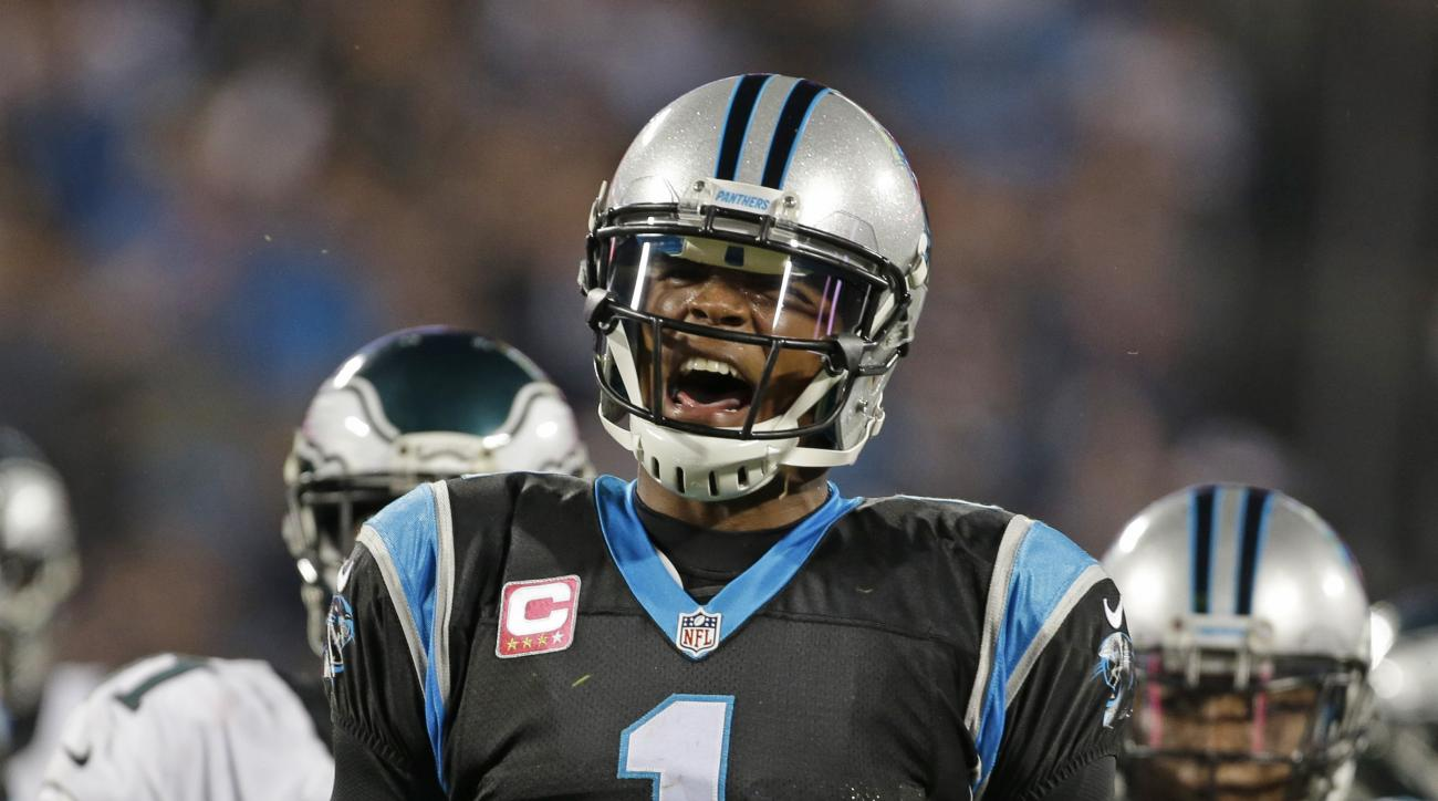 Carolina Panthers' Cam Newton (1) celebrates after a first down against the Philadelphia Eagles in the second half of an NFL football game in Charlotte, N.C., Sunday, Oct. 25, 2015. (AP Photo/Bob Leverone)