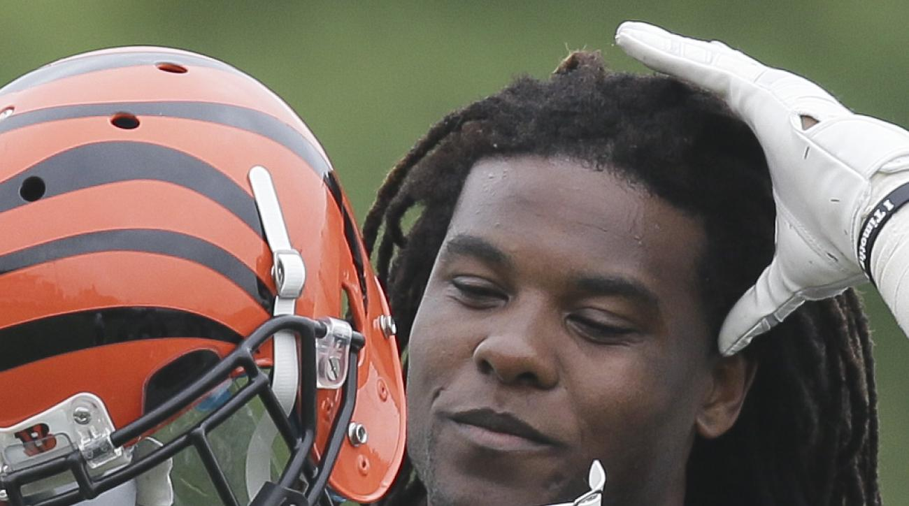 Cincinnati Bengals Fontaze Burfict replaces his helmet during organized team activities at the team's NFL football training fields, Tuesday, June 2, 2015, in Cincinnati. (AP Photo/John Minchillo)