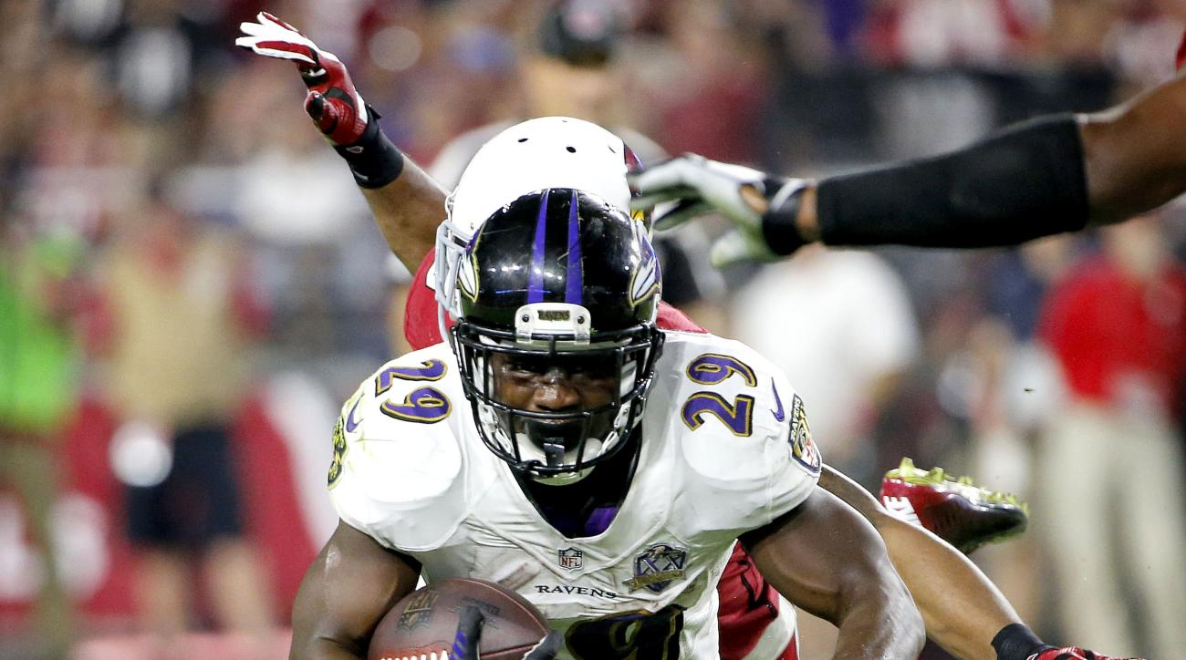 Baltimore Ravens running back Justin Forsett (29) is tackled during the first half of an NFL football game against the Arizona Cardinals, Monday, Oct. 26, 2015, in Glendale, Ariz. (AP Photo/Ross D. Franklin)