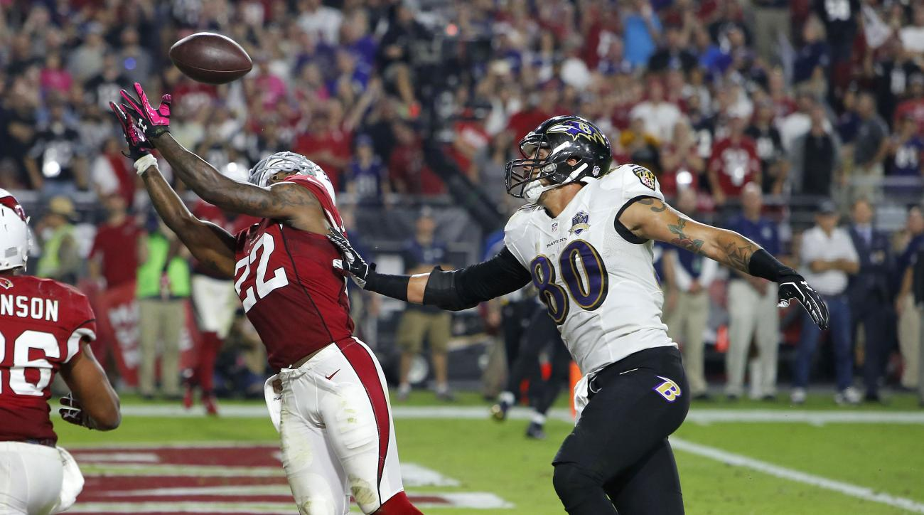 Arizona Cardinals strong safety Tony Jefferson (22) intercepts a  throw intended for Baltimore Ravens tight end Crockett Gillmore (80) in the end zone during the final seconds the second half of an NFL football game, Monday, Oct. 26, 2015, in Glendale, Ar