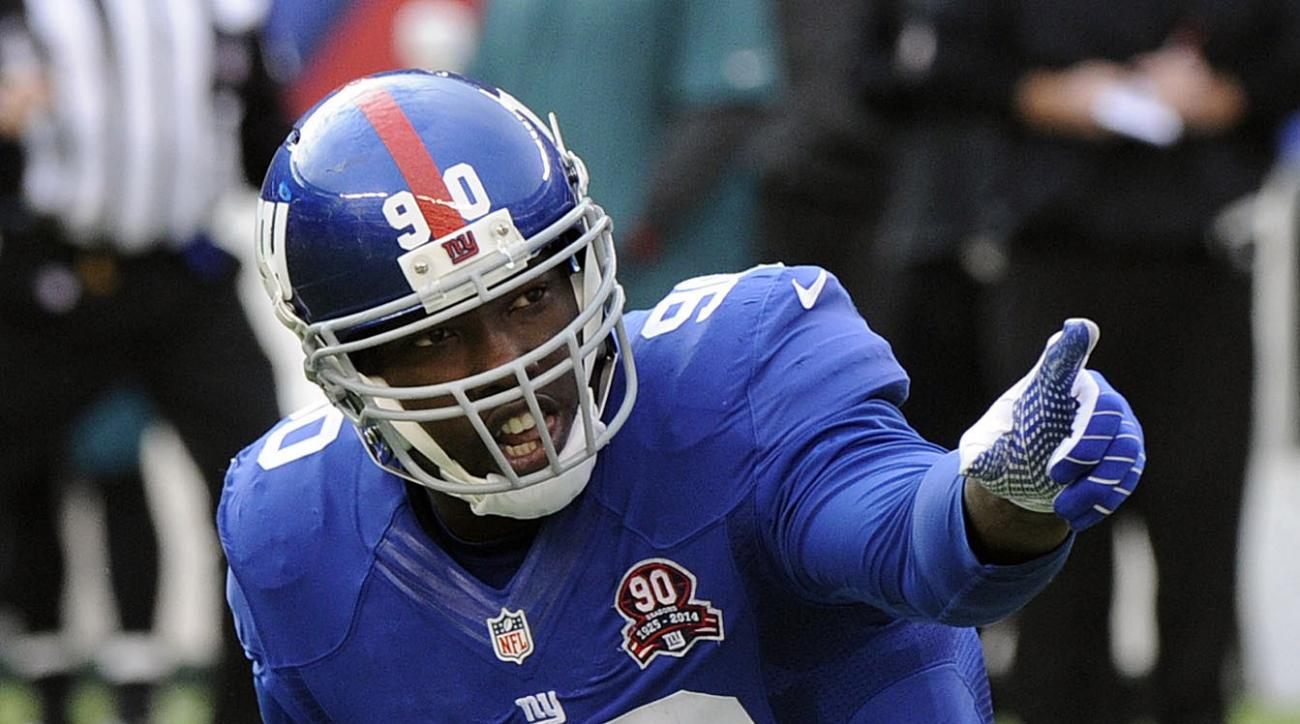 FILE - In this Sunday, Dec. 28, 2014, file photo, New York Giants' Jason Pierre-Paul (90) reacts after sacking Philadelphia Eagles' Mark Sanchez during the first half of an NFL football game in East Rutherford, N.J. Defensive end Jason Pierre-Paul and the