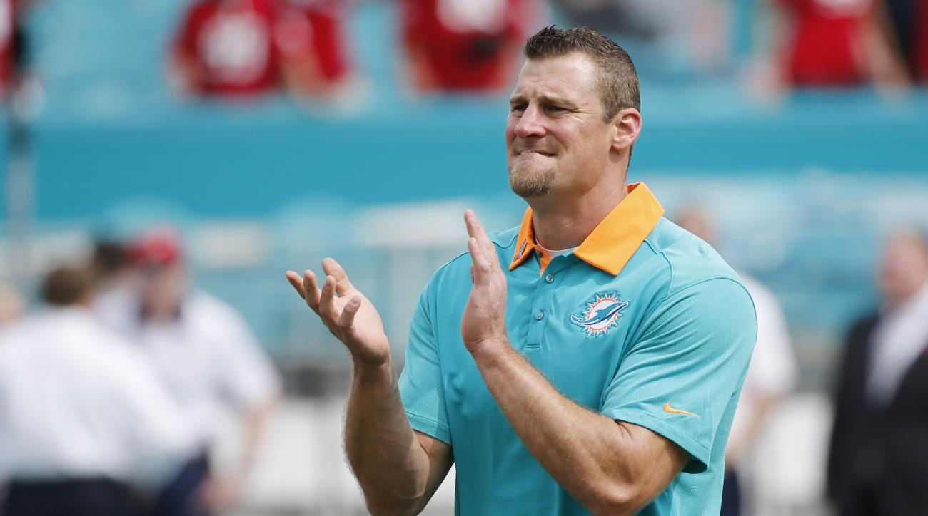 FILE - In this Sunday, Oct. 25, 2015 file photo, Miami Dolphins coach Dan Campbell claps before an NFL football game against the Houston Texans in Miami Gardens, Fla. In his locker room speech following his successful debut as Miami's interim head coach,