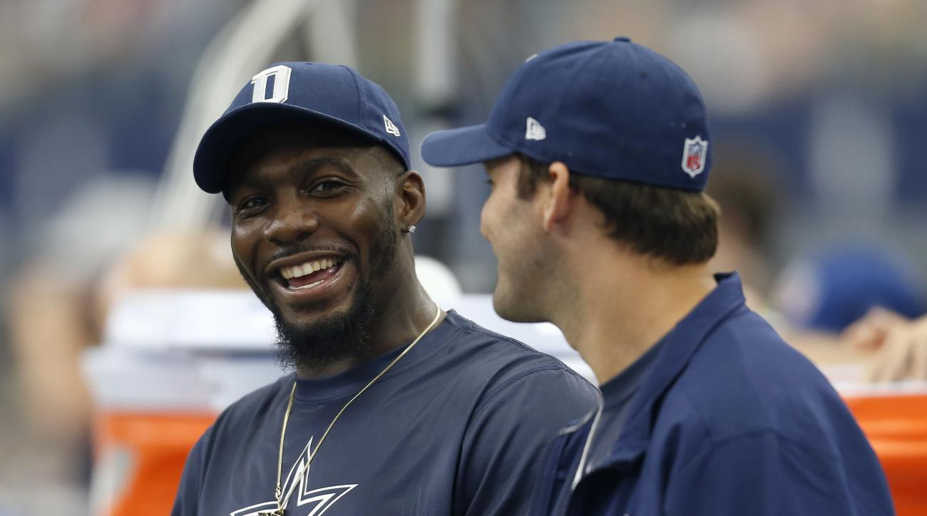 FILE - In this Sept. 27, 2015, file photo, Dallas Cowboys' Dez Bryant, left, and Tony Romo, right, talk on the sideline in the first half of an NFL football game against the Atlanta Falcons in Arlington, Texas. Bryant is returning to practice for the firs