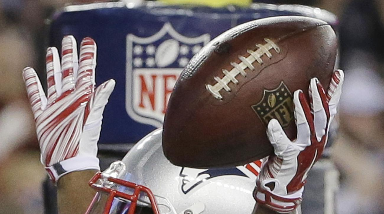 New England Patriots running back Dion Lewis celebrates his touchdown in the first half of an NFL football game against the Miami Dolphins, Thursday, Oct. 29, 2015, in Foxborough, Mass. (AP Photo/Steven Senne)