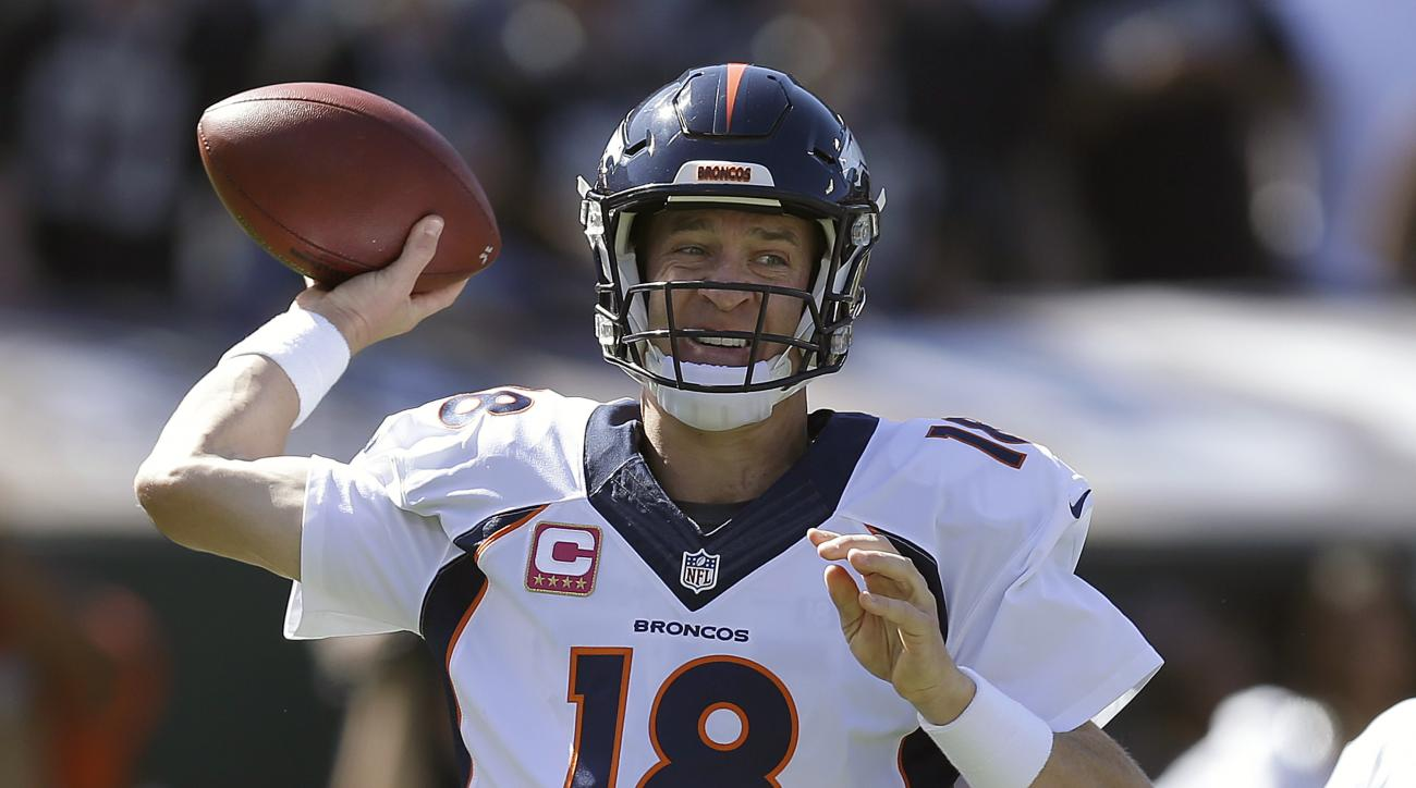 FILE - In this Oct. 11, 2015, file photo, Denver Broncos quarterback Peyton Manning (18) passes against the Oakland Raiders during the first half of an NFL football game in Oakland, Calif. Usually the hype machine points toward February and the Super Bowl