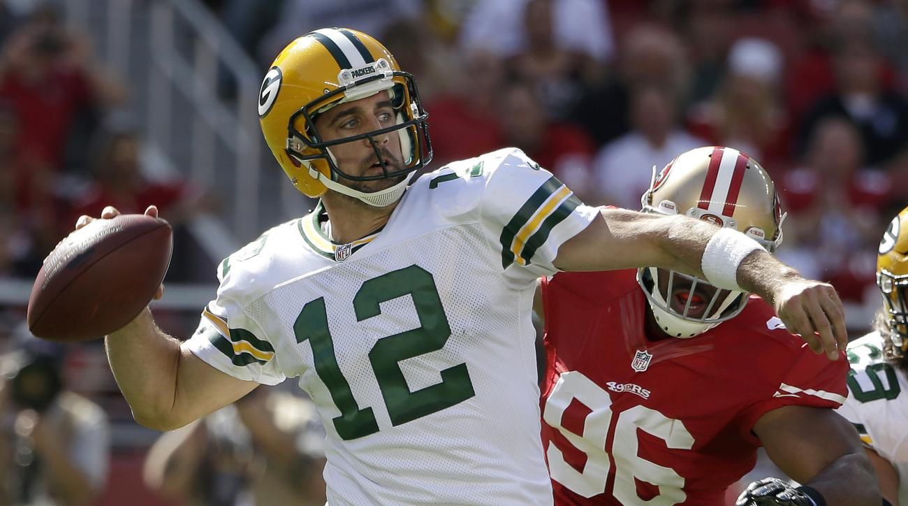 FILE - In this Oct. 4, 2015, file photo, Green Bay Packers quarterback Aaron Rodgers (12) passes as San Francisco 49ers linebacker Corey Lemonier (96) applies pressure during the first half of an NFL football game in Santa Clara, Calif. Usually the hype m