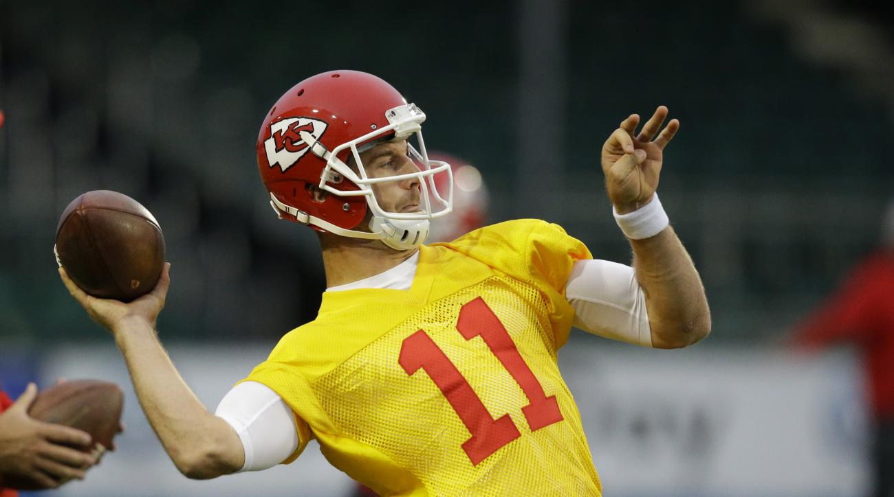 Kansas City Chiefs quarterback Alex Smith takes part in an NFL practice session at the Allianz Park rugby stadium in London, Friday, Oct. 30, 2015.  The Detroit Lions are due to play the Kansas City Chiefs at Wembley stadium in London on Sunday in a regul
