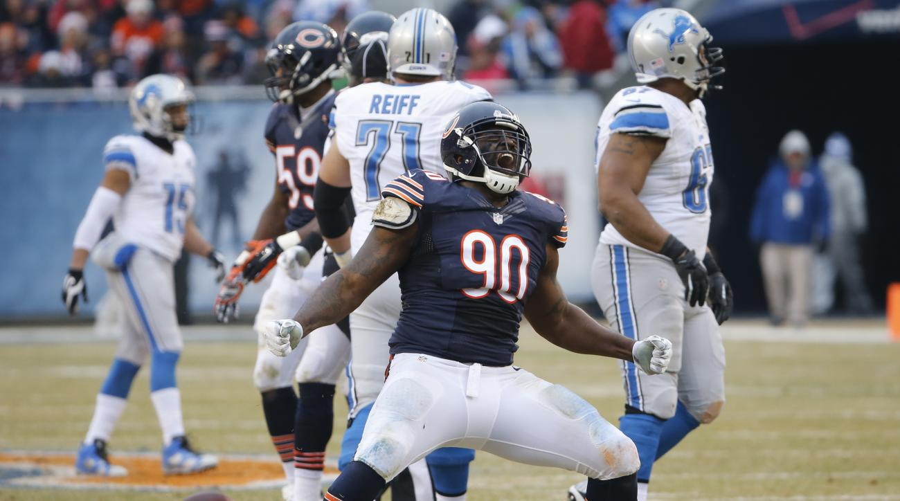 FILE - In this Dec. 21, 2014, file photo, Chicago Bears defensive tackle Jeremiah Ratliff (90) celebrates a sack in the first half of an NFL football game against the Detroit Lions in Chicago. The NFL has suspended Bears defensive lineman Jeremiah Ratliff