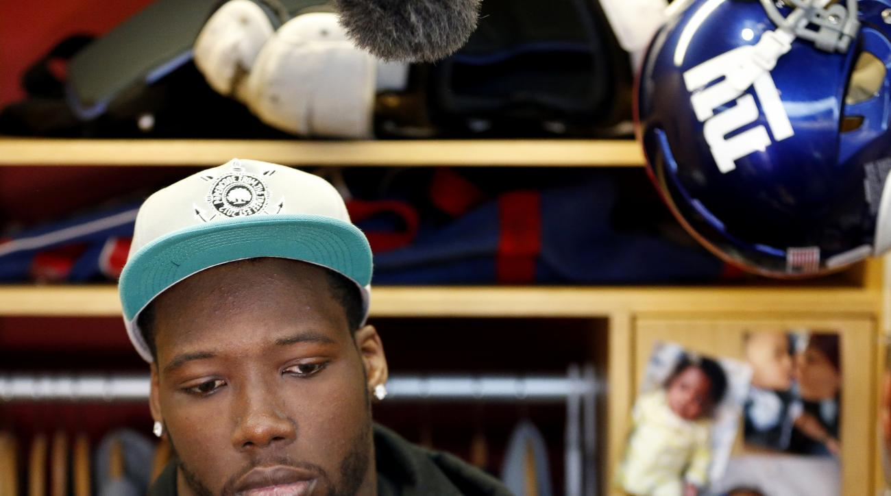 New York Giants defensive end Jason Pierre-Paul speaks to reporters for the first time since injuring his hand,  during NFL football practice, Friday, Oct. 30, 2015, in East Rutherford, N.J. Pierre-Paul hurt his hand while blowing up fireworks during July
