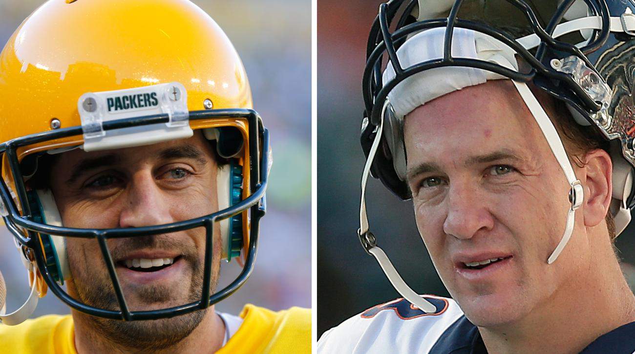 FILE - At left, in an Oct. 18, 2015, file photo, Green Bay Packers' Aaron Rodgers warms up for an NFL football game against the San Diego Chargers in Green Bay, Wis. At right, in a Nov. 9, 2014, file photo, Denver Broncos quarterback Peyton Manning stands