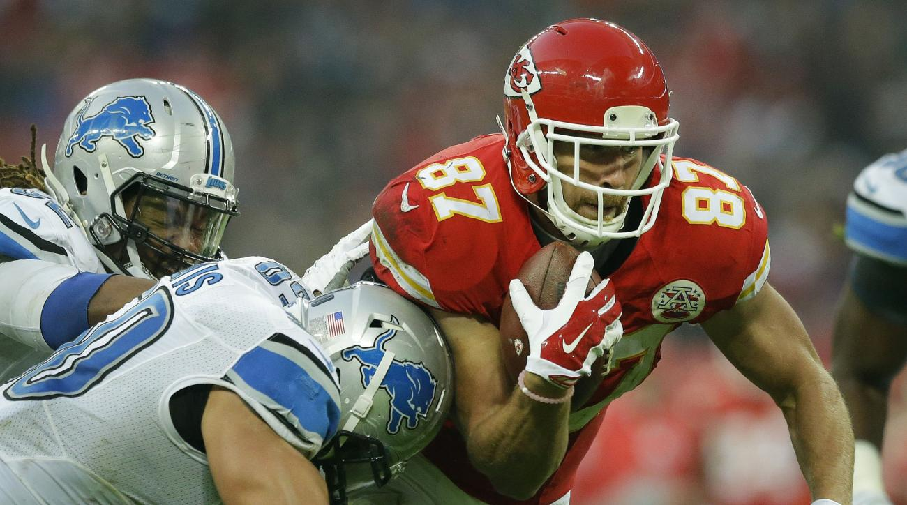 Kansas City Chiefs tight end Travis Kelce (87), right, is tackled during the NFL football game between Detroit Lions and Kansas City Chiefs Wembley Stadium in London,  Sunday, Nov. 1, 2015. (AP Photo/Matt Dunham)
