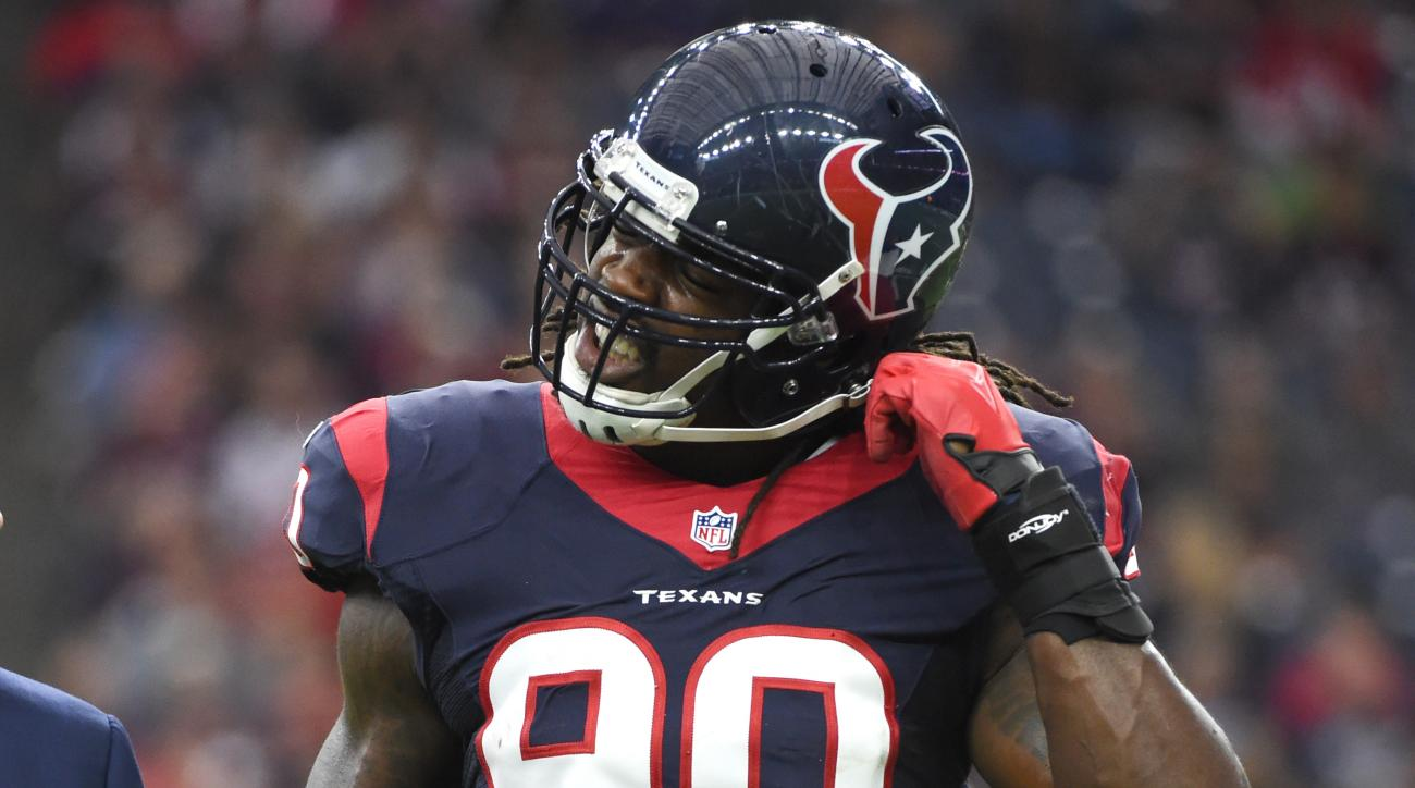 Houston Texans outside linebacker Jadeveon Clowney (90) walks off the field after he was hurt during the first half of an NFL football game against the Tennessee Titans, Sunday, Nov. 1, 2015, in Houston. (AP Photo/Eric Christian Smith)