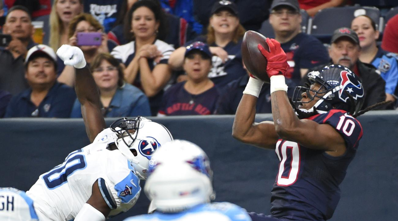 Houston Texans wide receiver DeAndre Hopkins (10) grabs a pass over Tennessee Titans cornerback Jason McCourty (30) for a touchdown during the first half of an NFL football game, Sunday, Nov. 1, 2015, in Houston. (AP Photo/Eric Christian Smith)