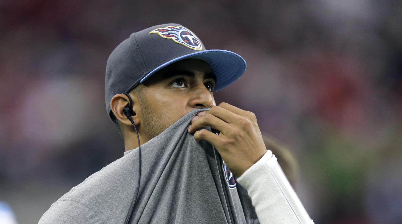 Tennessee Titans injured quarterback Marcus Mariota watches from the sideline during the first half of an NFL football game against the Houston Texans, Sunday, Nov. 1, 2015, in Houston. (AP Photo/Patric Schneider)
