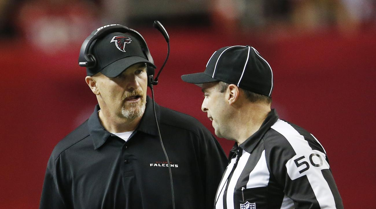 Atlanta Falcons head coach Dan Quinn speaks with an official during the first of an NFL football game against the Tampa Bay Buccaneers, Sunday, Nov. 1, 2015, in Atlanta. (AP Photo/John Bazemore)
