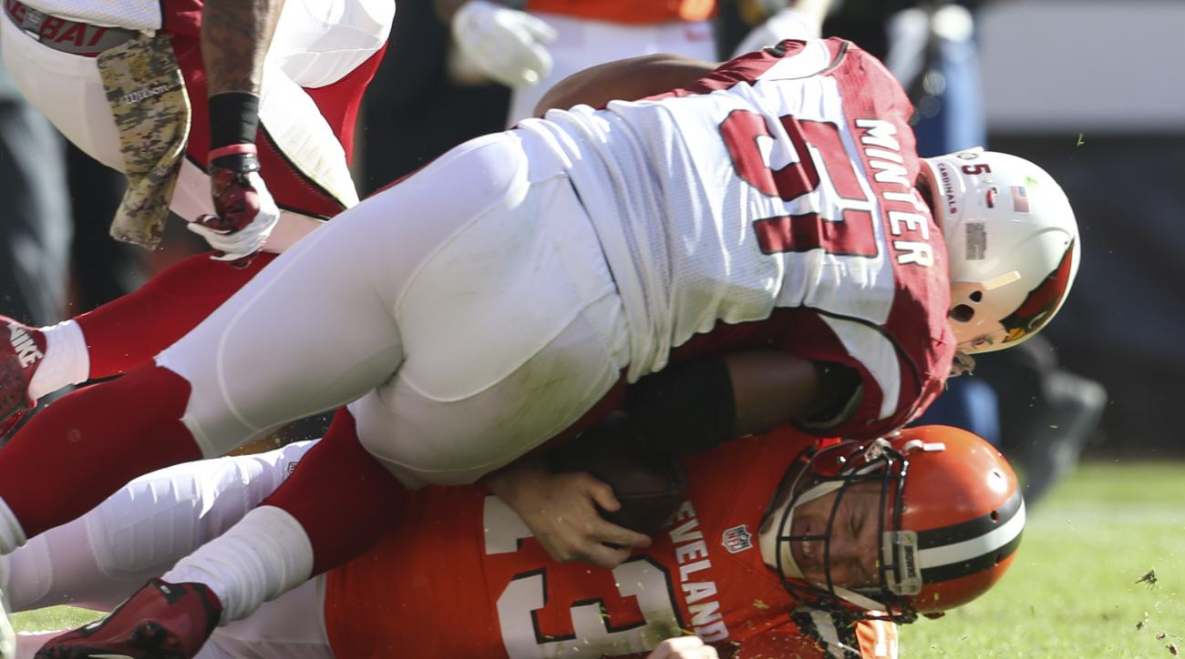 Cleveland Browns quarterback Josh McCown (13) is tackled by Arizona Cardinals middle linebacker Kevin Minter (51) in the first half of an NFL football game, Sunday, Nov. 1, 2015, in Cleveland. (AP Photo/Ron Schwane)