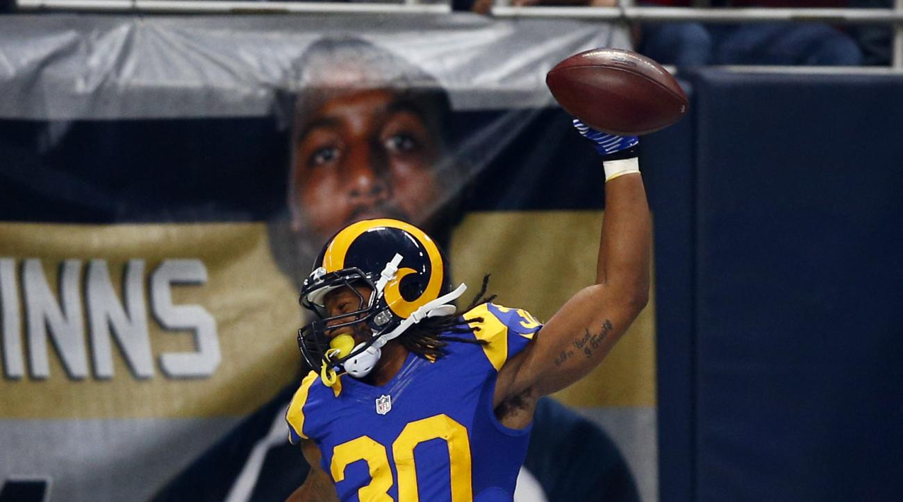 St. Louis Rams running back Todd Gurley celebrates after scoring on a 71-yard touchdown run during the second quarter of an NFL football game against the San Francisco 49ers, Sunday, Nov. 1, 2015, in St. Louis. (AP Photo/Billy Hurst)