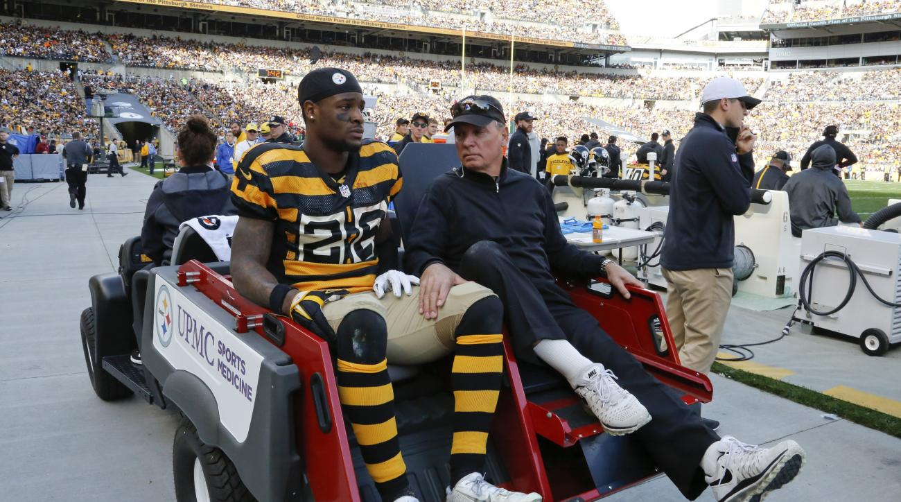 Pittsburgh Steelers running back Le'Veon Bell (26) is carted off the field after being injured in the second quarter of an NFL football game against the Cincinnati Bengals, Sunday, Nov. 1, 2015, in Pittsburgh. (AP Photo/Gene Puskar)