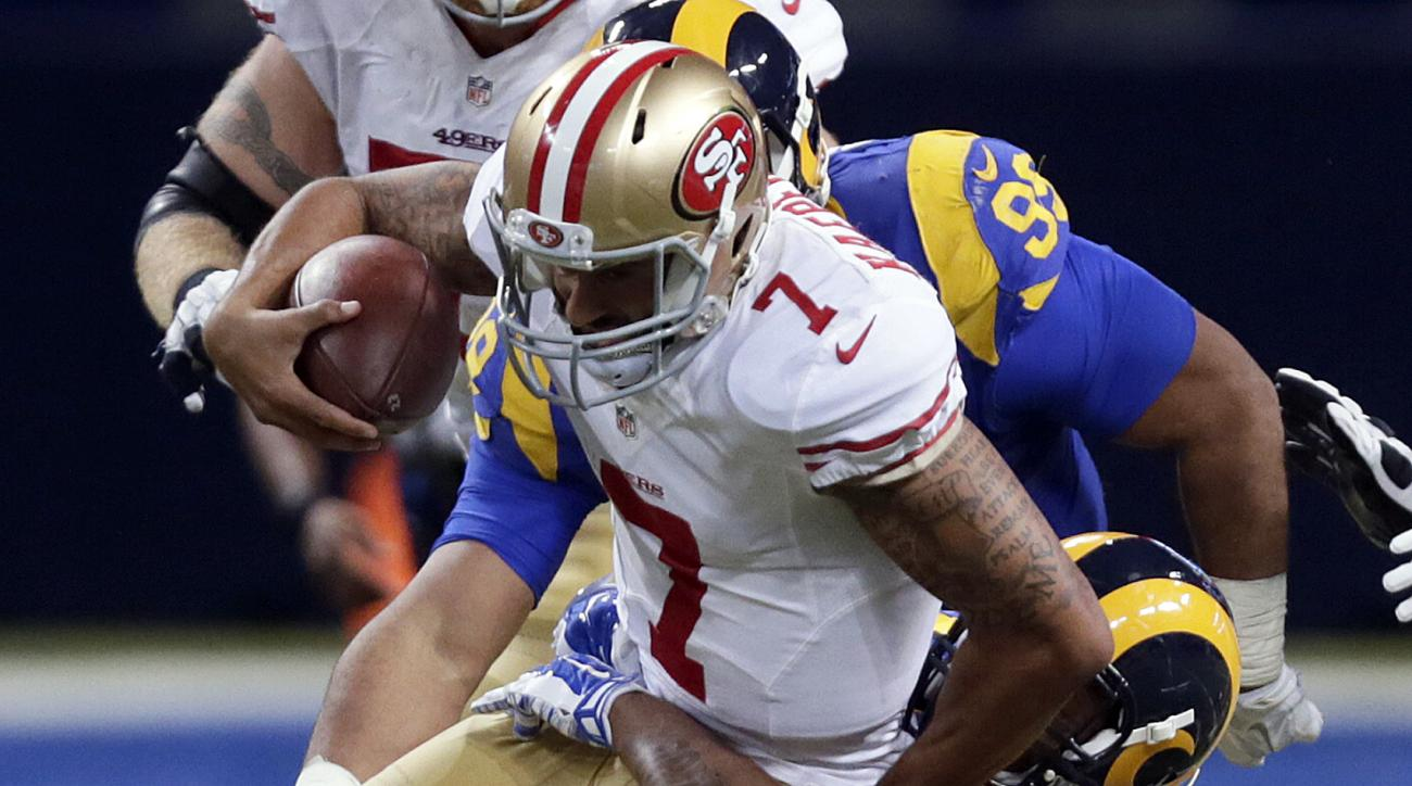 San Francisco 49ers quarterback Colin Kaepernick (7) is sacked for a 3-yard loss by St. Louis Rams defensive tackle Ethan Westbrooks during the fourth quarter of an NFL football game, Sunday, Nov. 1, 2015, in St. Louis. (AP Photo/Tom Gannam)