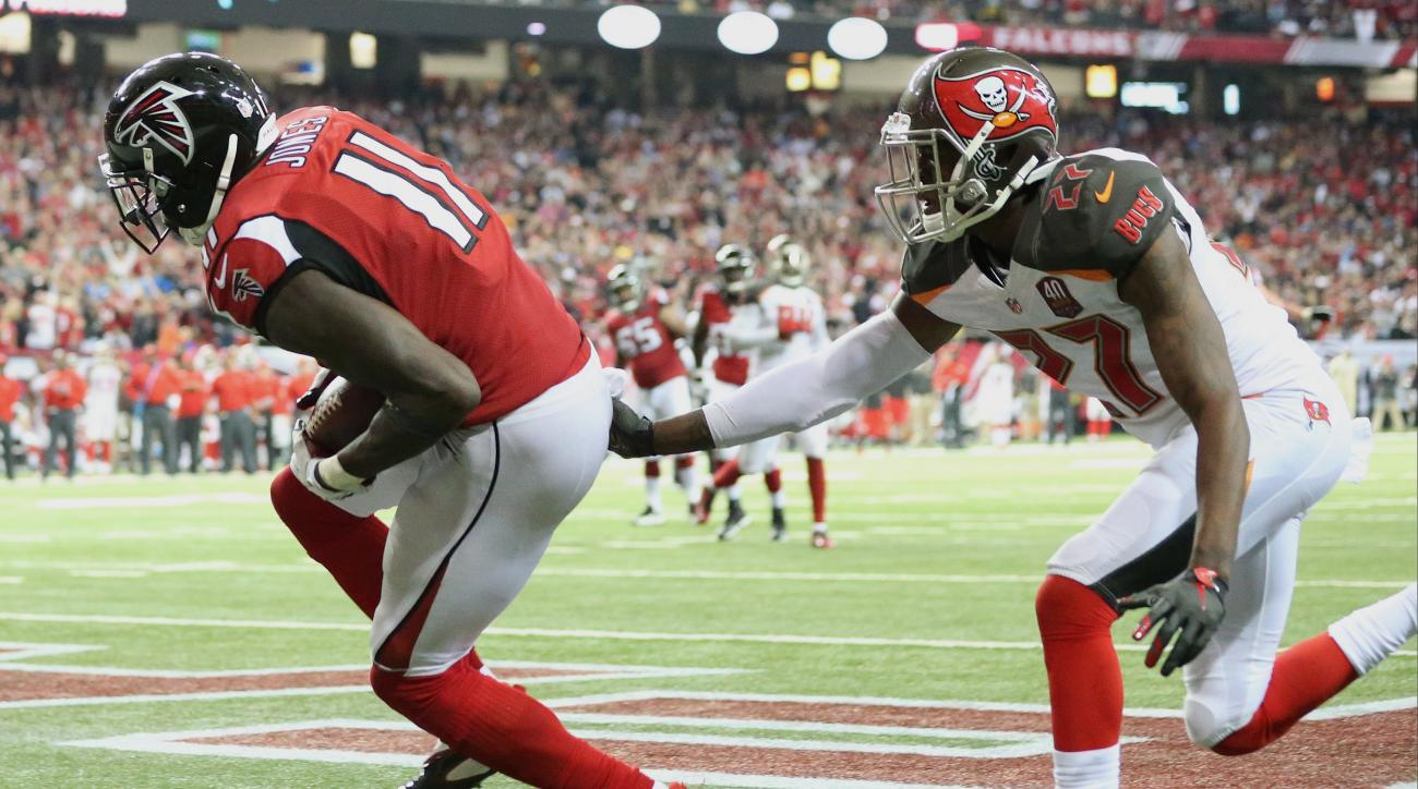 Atlanta Falcons wide receiver Julio Jones (11) makes a catch for a touchdown against Tampa Bay Buccaneers cornerback Johnthan Banks (27) during the second of an NFL football game, Sunday, Nov. 1, 2015, in Atlanta. (AP Photo/John Bazemore)