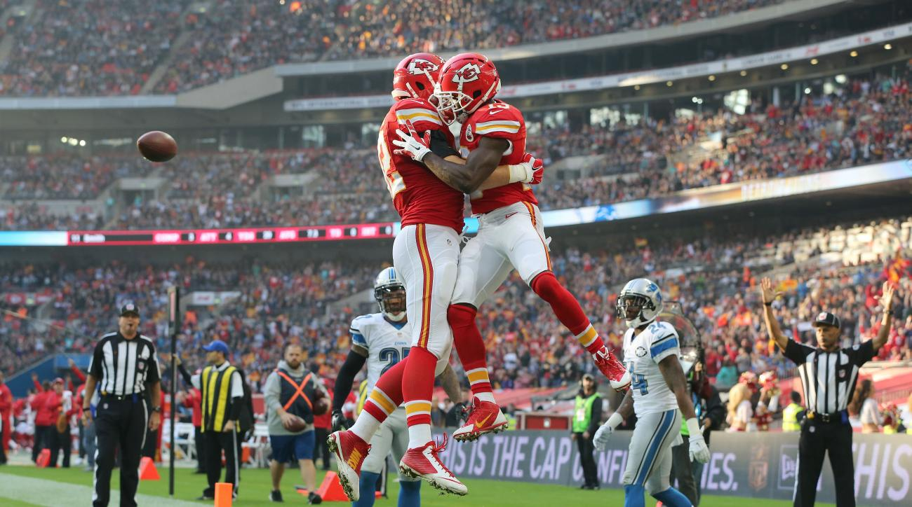 Kansas City Chiefs wide receiver De'Anthony Thomas (13), right, celebrates after scoring a touchdown during the NFL football game between Detroit Lions and Kansas City Chiefs Wembley Stadium in London,  Sunday, Nov. 1, 2015. (AP Photo/Tim Ireland)