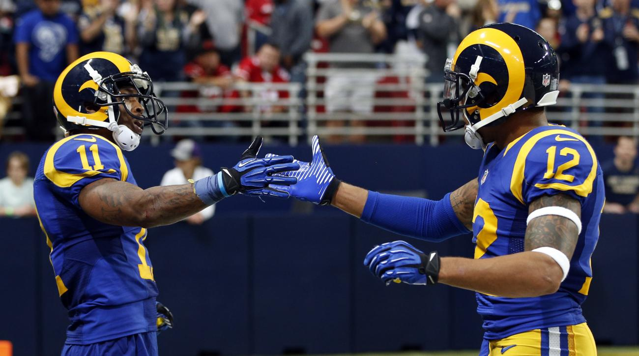 St. Louis Rams wide receiver Tavon Austin,  left, is congratulated by teammate Stedman Bailey, right, after catching a short pass and running it in for a touchdown during the fourth quarter of an NFL football game against the San Francisco 49ers, Sunday,